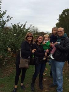 Rabbi Lynnda, daughter Beth, grandchildren Darren and Sage and husband Larry ready to board the hay ride at Johnson's Corner Farm